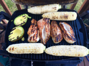 Grilling avocados deepens their flavor