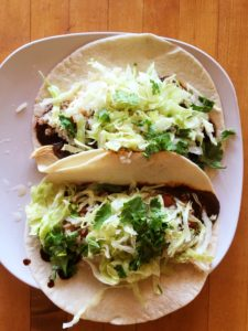 Chicken and red mole tacos